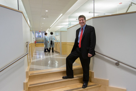 Dean Denis Kinane in the Syngcuk Kim Endodontic Clinic – operatories are on either side of a central corridor that includes a supply area and leads to private surgical suites on the east end.