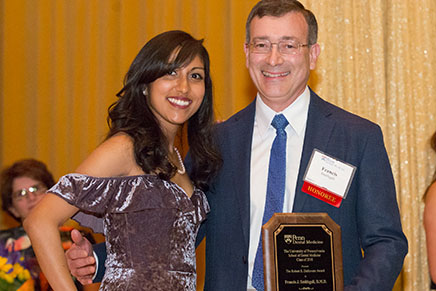 Dr. Frank Smithgall (C'79, D'83), Clinical Associate Professor of Restorative Dentistry,and student presenter; Dr. Smithgall received the Robert E. DeRevere Award for excellence in preclinical teaching by a part-time faculty member.