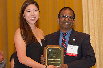 Dr. Mel Mupparapu (D'96), Professor of Oral Medicine and Director of Radiology, and student presenter; Dr. Mupparapu received the Basic Science Award for excellence in teaching within the basic sciences.
