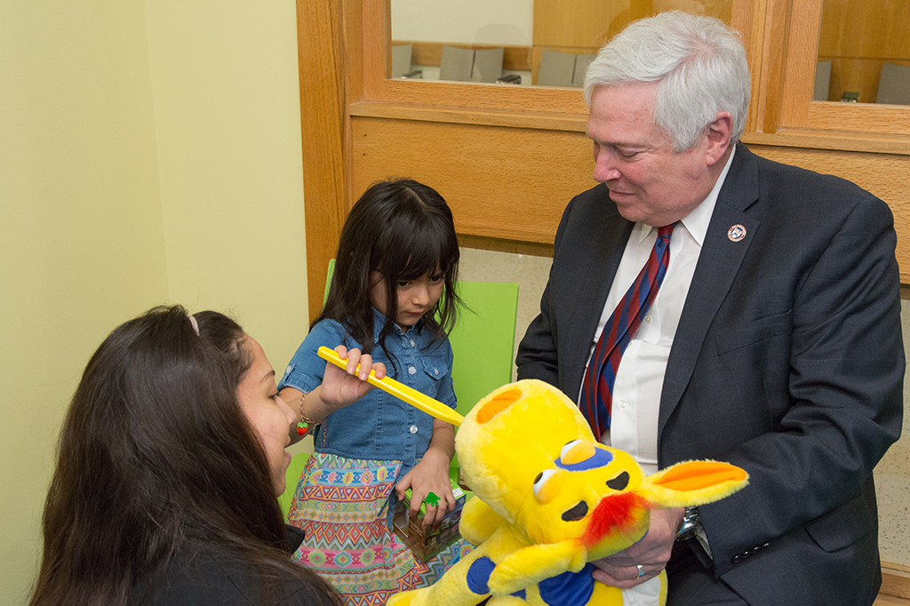 Dean Mark Wolff and one of the children who came for free care as part of Give Kids a Smile.