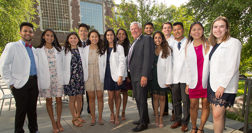 Members of the Class of 2023 with Dean Mark Wolff following the White Coat Ceremony.